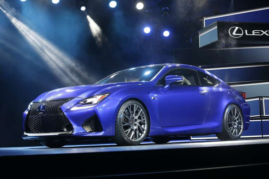 Lexus RC F coupe:Lexus is marking its 25th anniversary with some power. The RC F coupe is based on the RC coupe unveiled in November at the Tokyo Motor Show, but it's produced for high performance. The hood on the RC F is higher to accommodate a 5.0-liter, V8 engine that produces more than 450 horsepower. The automaker said the rear-wheel drive RC F also features a speed-sensitive, active rear spoiler that deploys at about 50 mph and retracts below 25 mph. The wing helps maintain traction and stability at higher speeds. Lexus expects the RC F to go on sale in early fall. Pricing hasn't been announced. Photo: Carlos Osorio, Associated Press