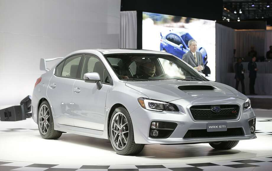 Subaru WRX STI: The 2015 WRX STI features a four-cylinder, 2.5-liter turbocharged engine with a 6-speed manual transmission that puts out 305 horsepower. The four-door, all-wheel drive STI version of the WRX aims to offer top-of-the-line performance along with comfort. Starting in April, Subaru plans to offer a WRX STI Launch Edition for three months, limited to 1,000 units and featuring special blue paint and gold-color forged alloy wheels. Pricing will be announced later.