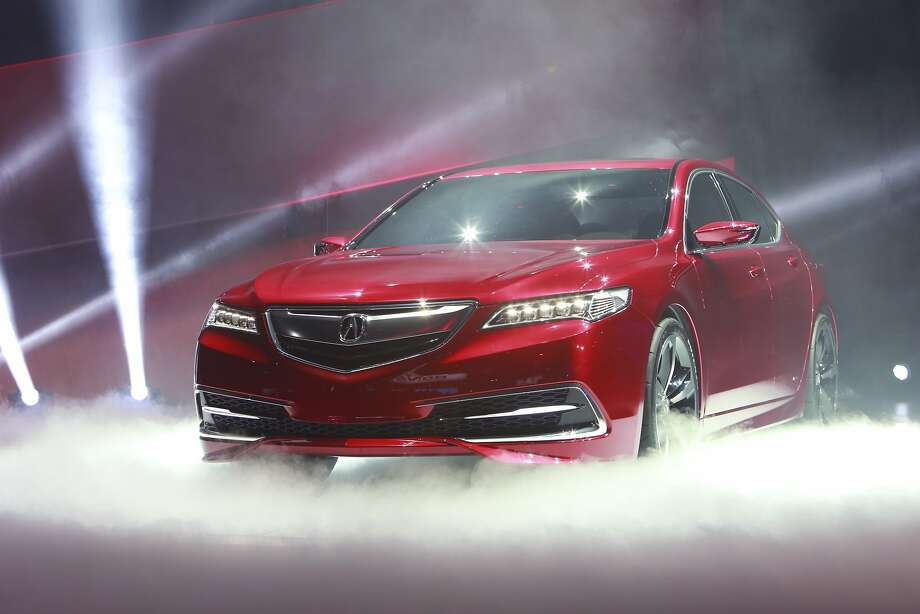 """Acura TLX:The Honda luxury brand plans to beef up its sedan line-up with a mid-season enhancement. Acura unveiled its 2015 TLX prototype, which it describes as a """"performance luxury sedan,"""" to join its ILX compact and RLX performance models. The sporty side comes through with a low and wide stance, rigid and lightweight body, and shortened front and rear overhangs. The car will come with a new 2.4-liter four-cylinder engine or more powerful 3.5-liter V6. The carmaker says that high performance won't compromise luxury, with the TLX offering """"vault-like quietness"""" in all driving conditions. The TLX was designed and developed in the U.S., where it will also be produced. Photo: Fabrizio Costantini, New York Times"""