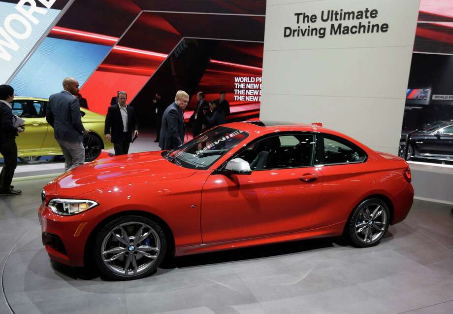 BMW 2 Series coupe, M3 sedan, M4 coupe: The two-door, four-seat, rear-wheel drive 2 Series Coupe — the replacement for the 1 Series Coupe — will come in a 228i version, which features a 240 horsepower, 2.0-liter V4 engine, and the M235i version, which features a 322 horsepower, 3.0-liter V6 engine. The 228i promises zero to 60 mph acceleration in 5.4 seconds while offering 22-23 mph in the city and 34-35 mpg on the highway, depending on the transmission. With the M235i, drivers can go from zero to 60 mph in 4.8 seconds with a top speed of 155 mph. Gas mileage isn't as good, at 19-22 mpg in city driving and 28-32 mpg on the highway. Scheduled to go on sale starting in March, BMW plans to sell the 228i for $33,025 and the M235i for $44,025. BMW also is showing its new 2015 model M3 Sedan and M4 Coupe. Plans call for the cars to go on sale in early summer, with pricing and options announced in the coming months. Photo: Carlos Osorio, AP / AP