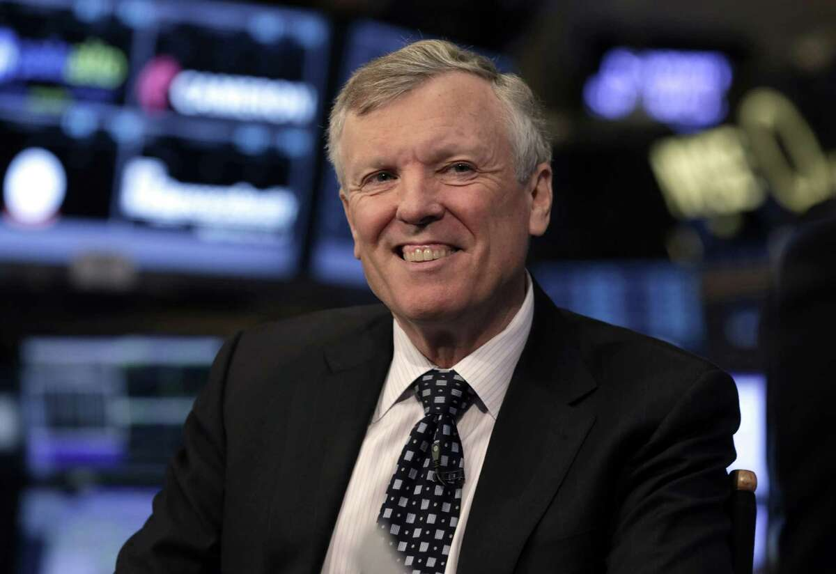 Charter Communications CEO Thomas Rutledge is interviewed on the floor of the New York Stock Exchange, Tuesday, Jan. 14, 2014. Time Warner Cable rose 2 percent after the company rejected a takeover offer from Charter Communications. (AP Photo/Richard Drew)
