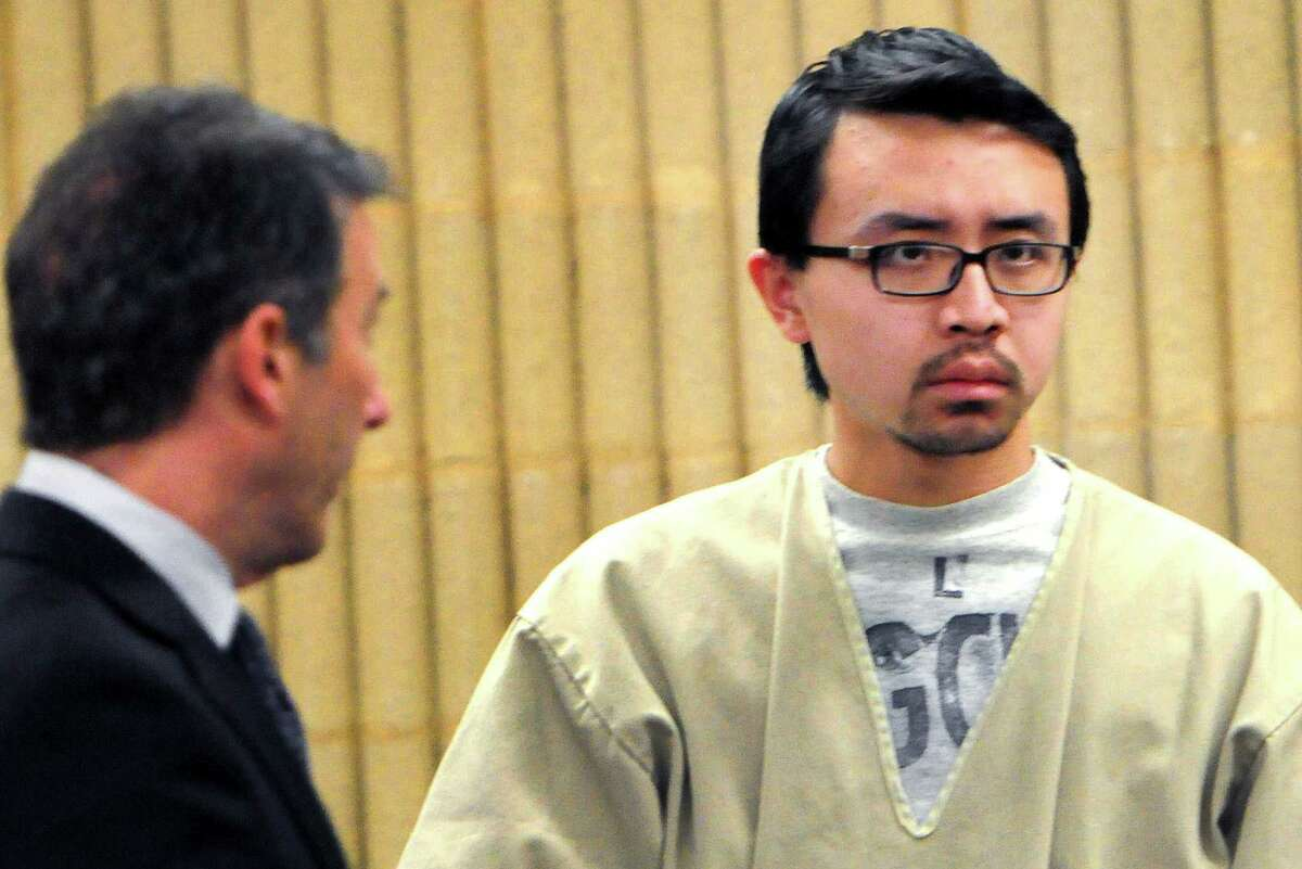 William Dong, right, stands with his lawyer Fred Paoletti Tuesday, Jan. 14, 2014 during a hearing in Milford, Conn., Superior Court. State's Attorney Kevin D. Lawlor is at far left. Dong to pleaded not guilty to weapons charges stemming from a gun scare at the University of New Haven in December.