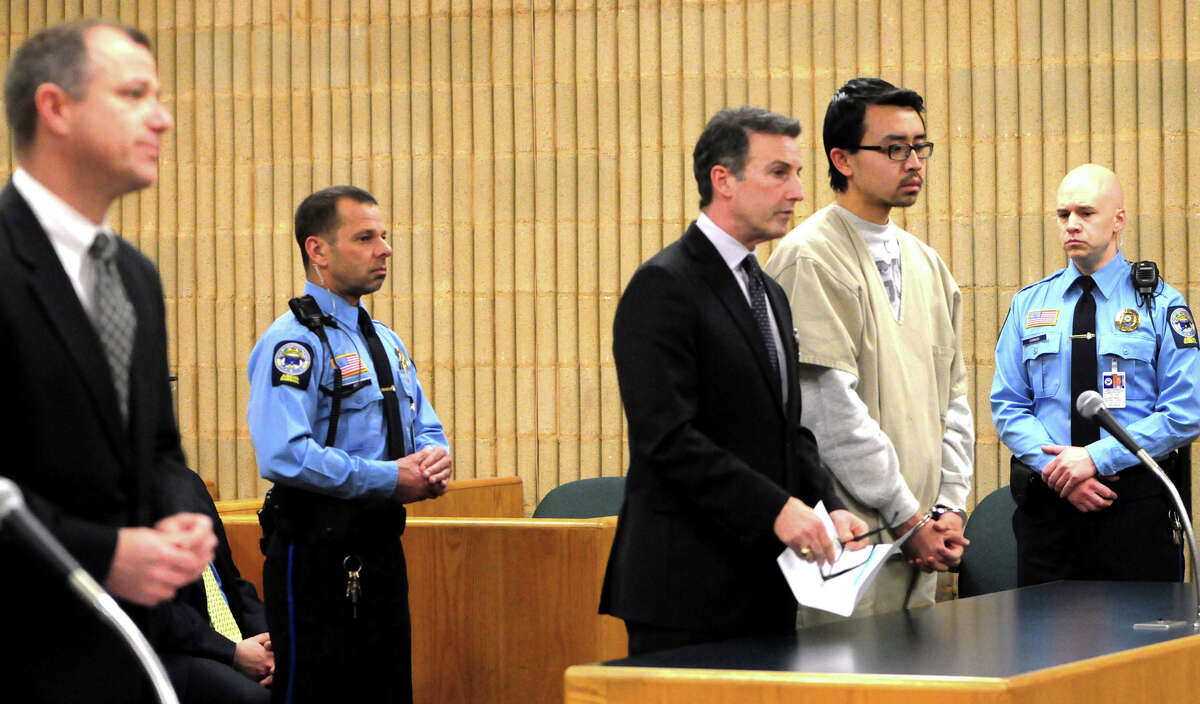 William Dong, second from right, stands with his lawyer Fred Paoletti Tuesday, Jan. 14, 2014 during a hearing in Milford, Conn., Superior Court. State's Attorney Kevin D. Lawlor is at far left. Dong to pleaded not guilty to weapons charges stemming from a gun scare at the University of New Haven in December.