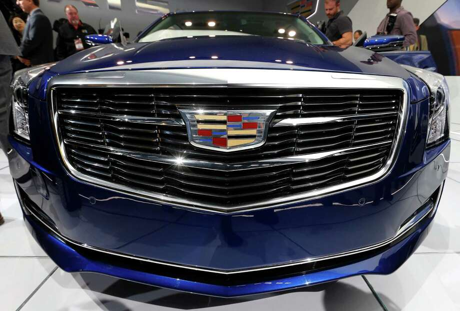The new Cadillac logo is shown on the 2015 ATS coupe during its debut at media previews during the North American International Auto Show in Detroit, Tuesday, Jan. 14, 2014. Photo: Paul Sancya, AP / AP