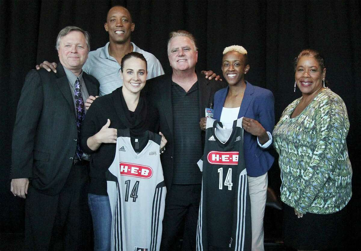 San Antonio Stars head coach Dan Hughes (from left), former Spurs player Sean Elliott, Stars' Becky Hammon, H-E-B Vice President of Marketing Cory Basso, Stars' Danielle Robinson and WNBA President Laurel Richie pose for pictures as the Stars - formerly called the Silver Stars - announce a change in their team name and logo along with their first ever marquee sponsor, H-E-B, after a press conference at the AT&T Center on Tuesday, Jan. 14, 2014.