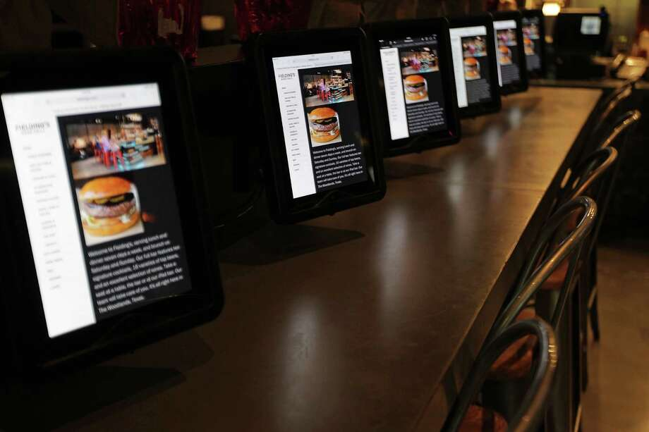 The iPad bar at Fielding's Wood Grill. Photo: James Nielsen, Staff / © 2013  Houston Chronicle