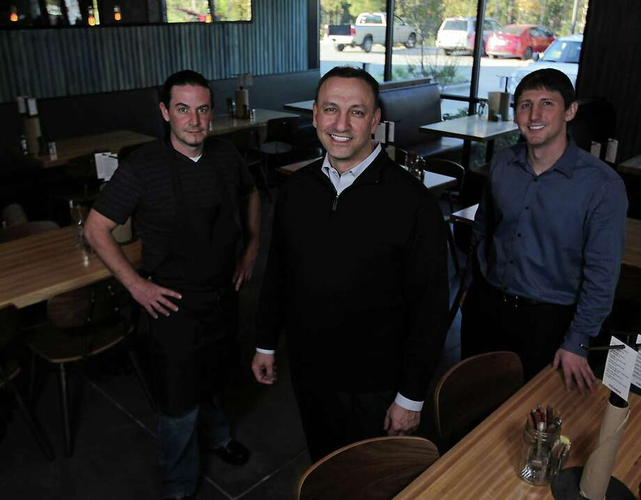 Fielding's founders Edelberto Gonçalves, left, Cary Attar, center, and Matt Kotis have created a space that feels more like a restaurant than a burger joint. Photo: James Nielsen, Staff / © 2013  Houston Chronicle