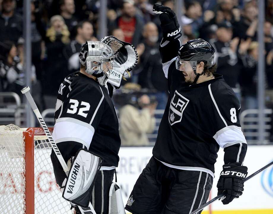 LOS ANGELES, CA - JANUARY 13:  Drew Doughty #8 of the Los Angeles Kings celebrates a 1-0 win with Jonathan Quick #32 over the Vancouver Canucks at Staples Center on January 13, 2014 in Los Angeles, California.  (Photo by Harry How/Getty Images) Photo: Harry How, Getty Images