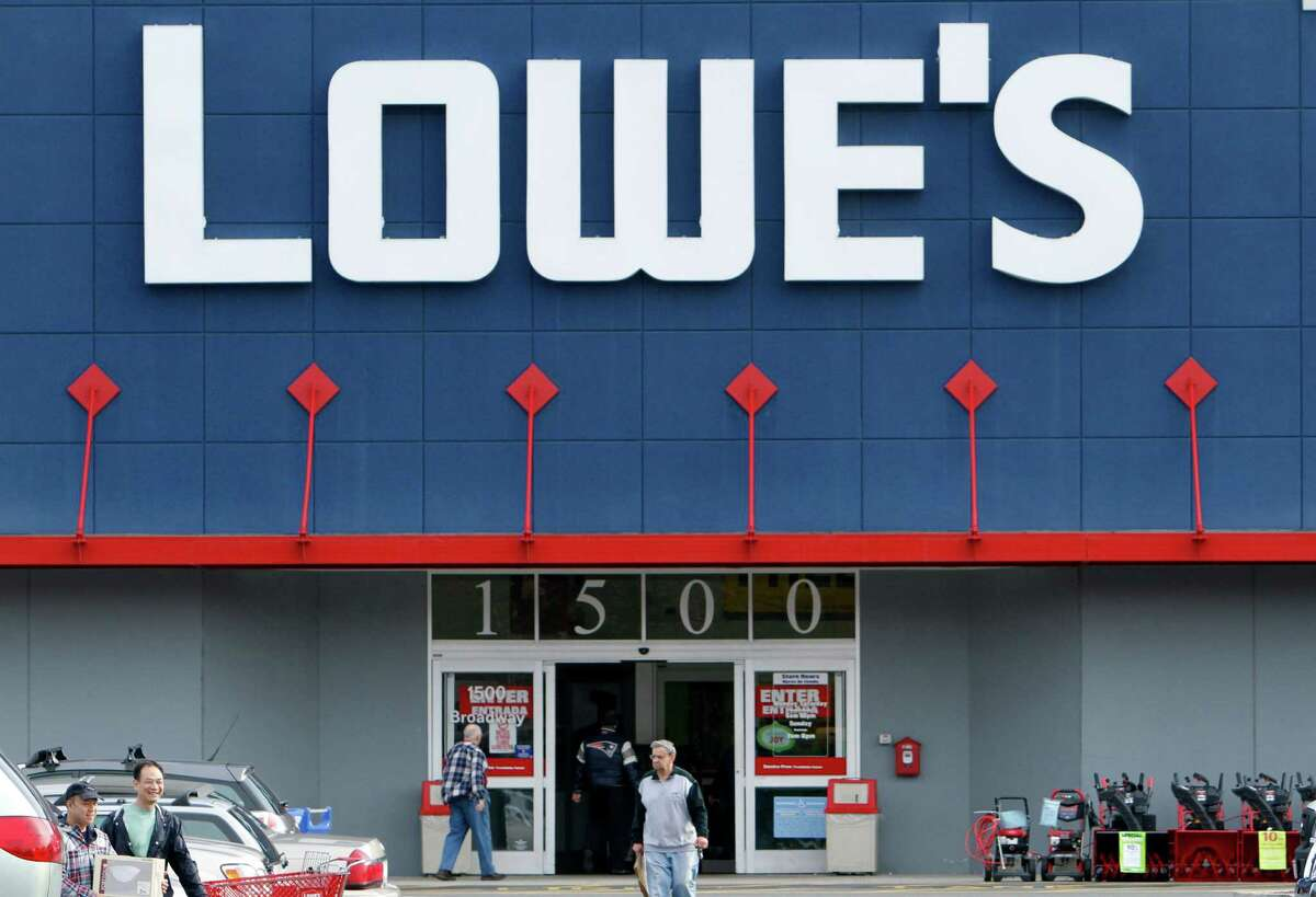 FILE - In a Nov. 14, 2011 file photo customers enter and exit a Lowe's store in Saugus, Mass. (AP Photo/Michael Dwyer, file)