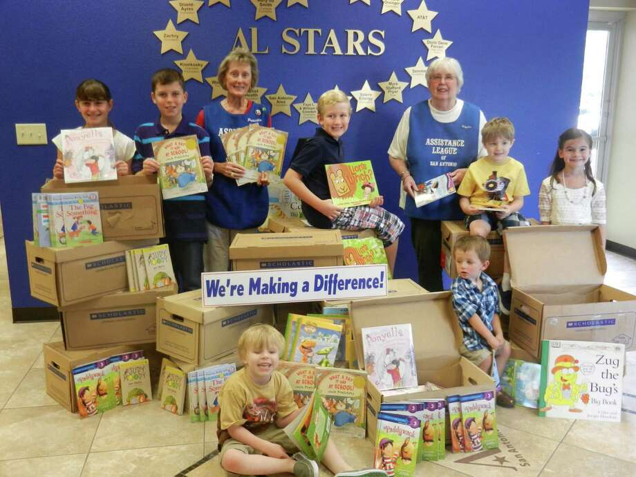 Priscilla Allen, left, and Betty Sue Hayes, right, of the Assistance League of San Antonio, are surrounded by children and books from the league's literacy project. The league provided 14,443 books for distribution at local school districts, shelters and libraries in 2013. Judson ISD received 3,309 books. Photo: Courtesy