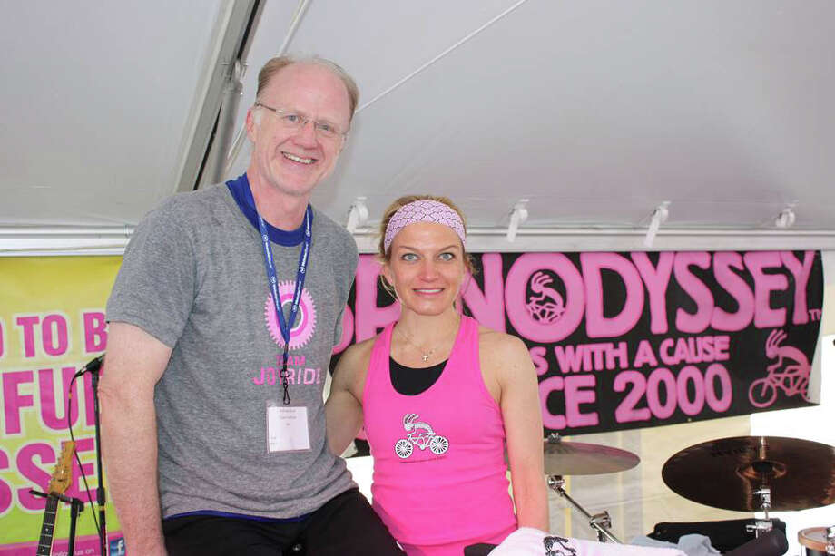 Team JoyRide's Andrew Beal, with JoyRide co-owner and SpinOdyssey presenter Rhodie Lorenz, was the top individual fundraiser at the 2013 SpinOdyssey, raising $23,500 for breast cancer research. Photo: Contributed Photo, Contributed / New Canaan News Contributed