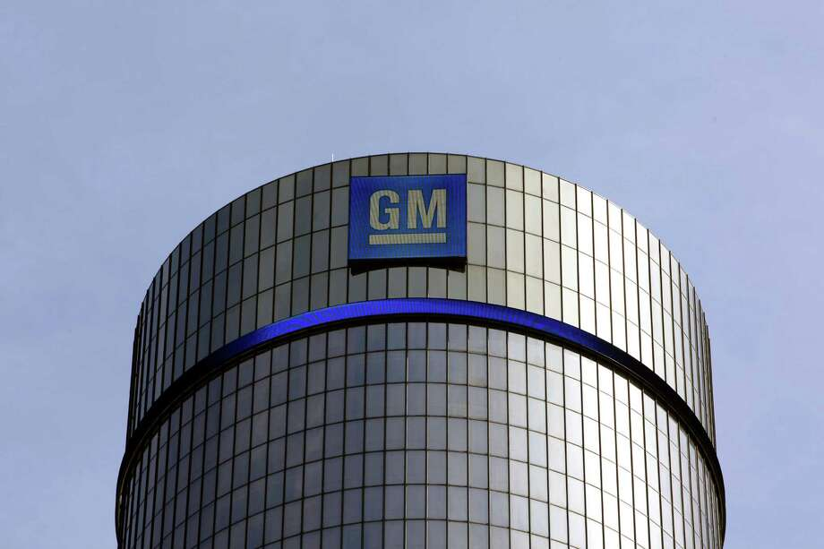 FILE - In this  Thursday, May 5, 2011, file photo, General Motors headquarters are shown in Detroit. General Motors sold 9.71 million cars and trucks  in 2013, probably not enough to beat out Toyota for the global sales crown, but about 200,000 better than Volkswagen. (AP Photo/Paul Sancya, File) ORG XMIT: NYBZ128 Photo: Paul Sancya / AP