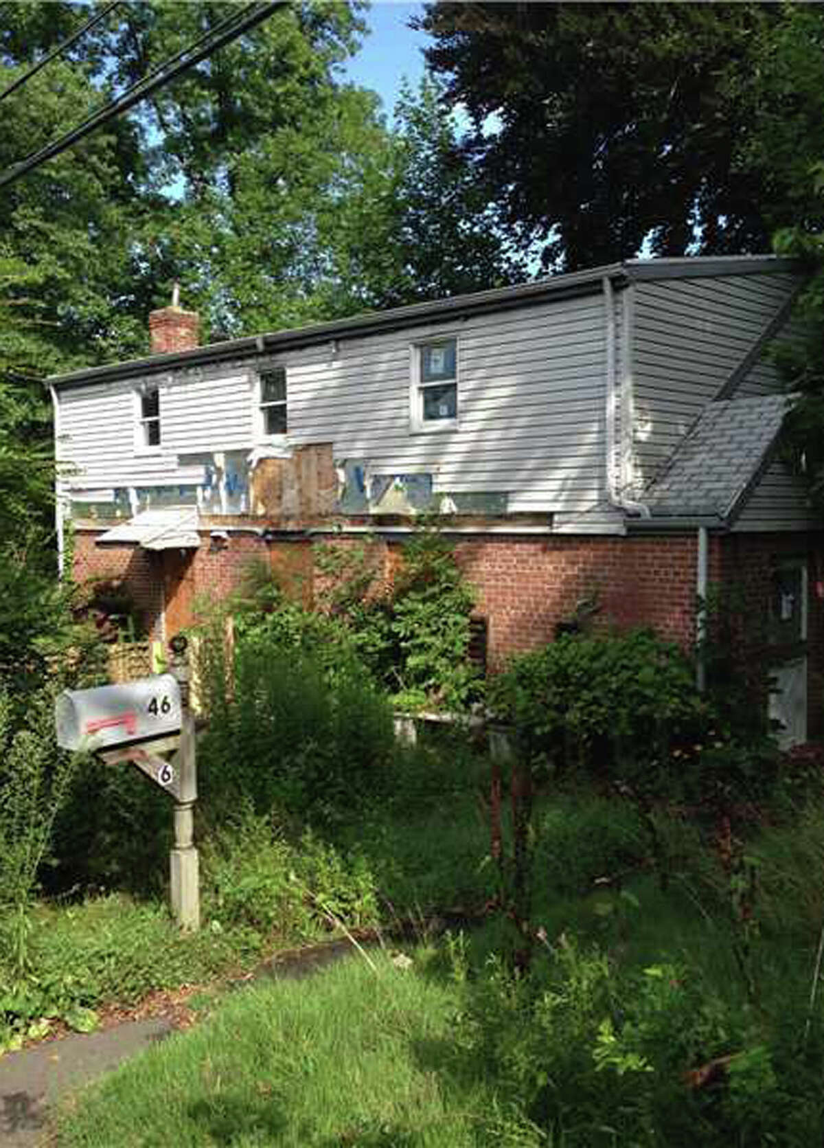 """The first of two """"Buys of the Week"""" from Ken Edwards is the property at 46 Havemeyer Lane, a fire-damaged 1947 brick colonial home, that sold for $387,500."""