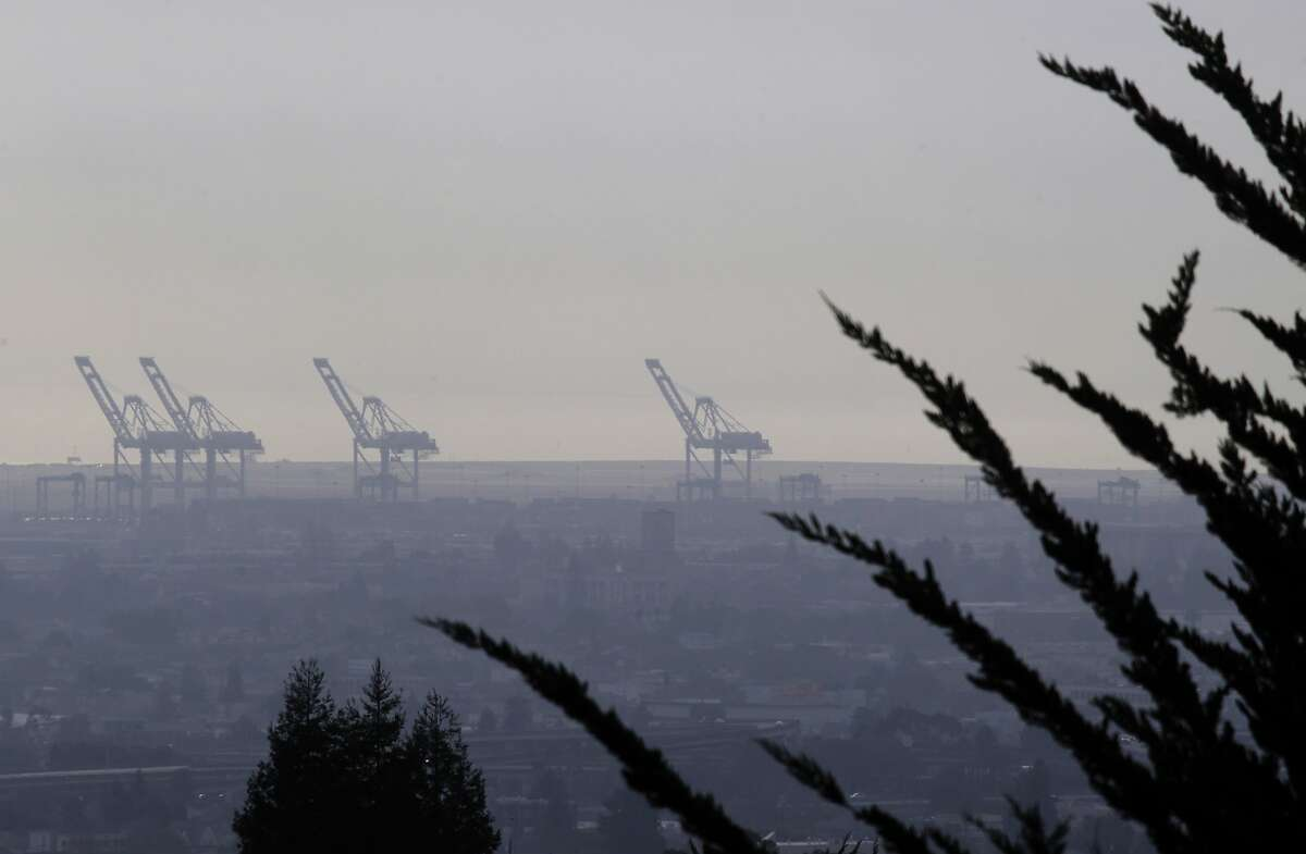 Gantries at the Port of Oakland are barely visible through the haze in Oakland, Calif. on Tuesday, Jan. 7, 2014. Unseasonably warm and dry weather has resulted in unusual hazy conditions and a high number of Spare the Air days.