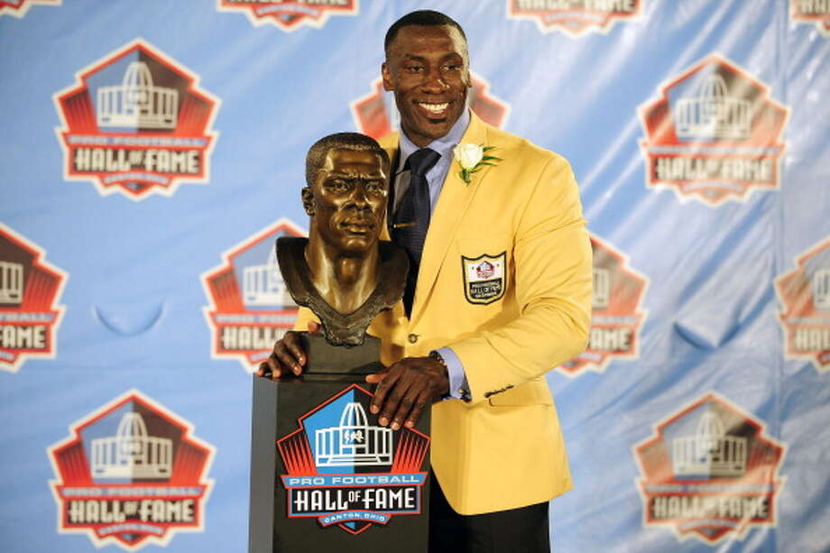 """Former Broncos tight end Shannon Sharpe says the NFL league's policy toward marijuana will never change """"because of the way kids follow what NFL players do.""""But as the  Washington Post points out: """"Sorry, Mr. Sharpe, but kids who idolize NFL players are already bombarded by beer ads, the contracts for which enrich team owners and, by extension, players. And alcohol is objectively more harmful than marijuana in terms of its damage to the body, its addictiveness and its association with violent behavior.""""Photo: Shannon Sharp poses with his bust at the Enshrinement Ceremony for the Pro Football Hall of Fame on August 6, 2011 in Canton, Ohio. Photo: Jason Miller, Getty Images / 2011 Getty Images"""