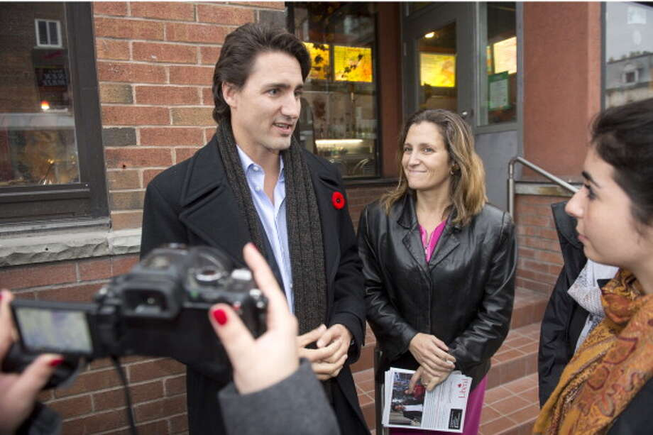 "Canada's Conservative government responded to Federal Liberal Leader Justin Trudeau's call for legalization and admission of pot use:""These drugs are illegal because of the harmful effect they have on users and on society,"" the party wrote on its website. ""We will continue protecting the interests of families across this country. Our government has no interest in seeing marijuana legalized or made more easily available to youth.""Until it comes to alcohol, then we won't.Photo: Chrystia Freeland, Liberal candidate in the Toronto Centre byelection, campaigns on Church Street, helped by party leader Justin Trudeau. Photo: Keith Beaty, Toronto Star Via Getty Images / 2013 Toronto Star"