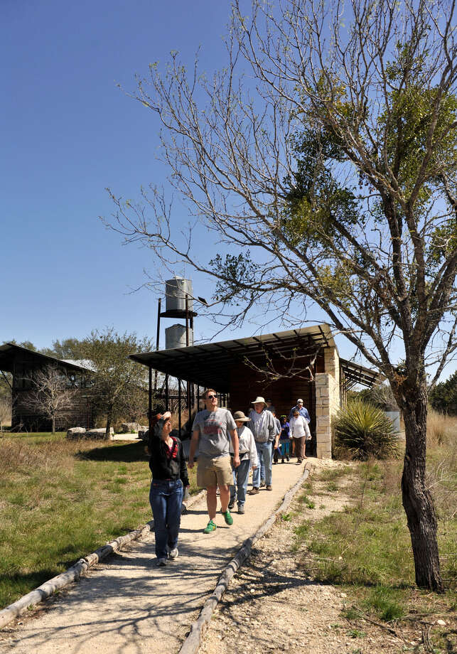 Hikers leave the visitors Center at Government Canyon State Natural area last spring for a wildflower hike. Photo: File Photo