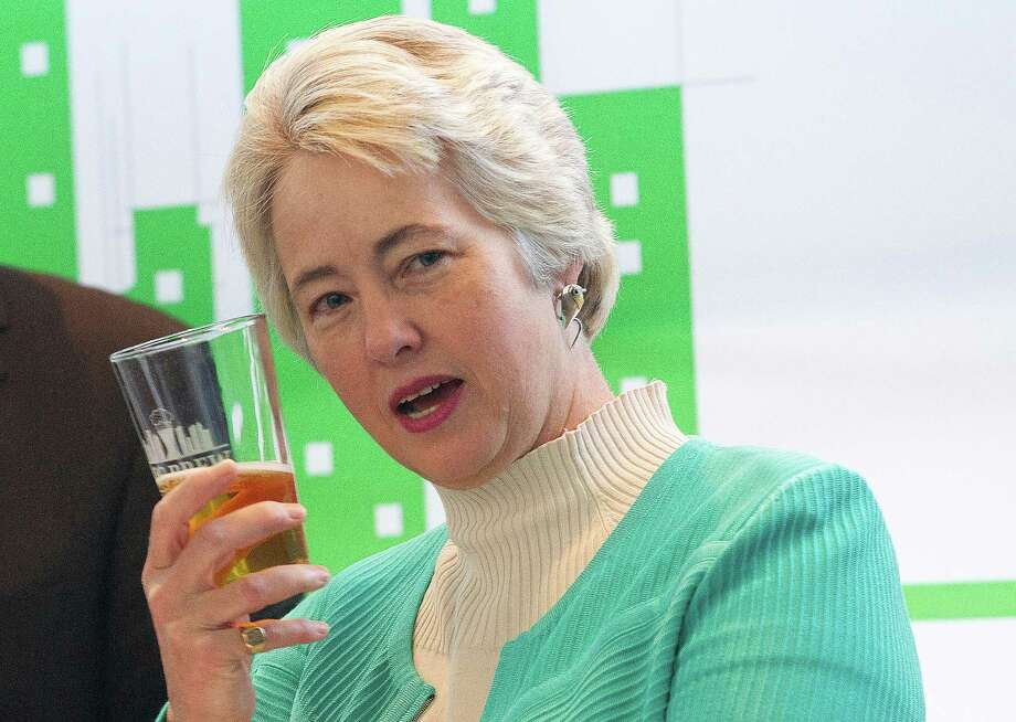 Mayor Annise Parker says a toast after announcing Big Brew, a destination craft beer event at the George R. Brown Convention Center Tuesday, Jan. 14, 2014, in Houston.  Big Brew will be a week-long celebration kicks off Oct. 20, 2014. The event will feature more than 1,000 beers, brewmasters from the craft beer industry, seminars, pub crawls and craft beer dinners. ( Johnny Hanson / Houston Chronicle ) Photo: Johnny Hanson, Staff / © 2014  Houston Chronicle