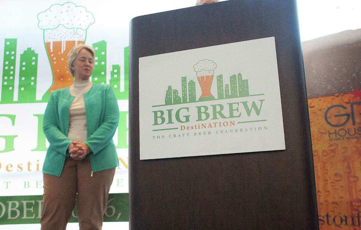 Mayor Annise Parker waits to announce Big Brew, a destination craft beer event during a press conference at the George R. Brown Convention Center Tuesday, Jan. 14, 2014, in Houston. Big Brew will be a week-long celebration kicks off Oct. 20, 2014. The event will feature more than 1,000 beers, brewmasters from the craft beer industry, seminars, pub crawls and craft beer dinners. ( Johnny Hanson / Houston Chronicle )
