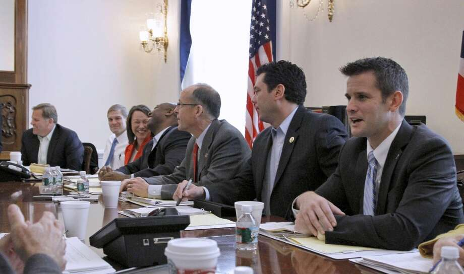 "Rep. Adam Kinzinger (right), R-Ill., @repkinzinger - ""Damn, you suck."" Photo: Alex Brandon, AP"