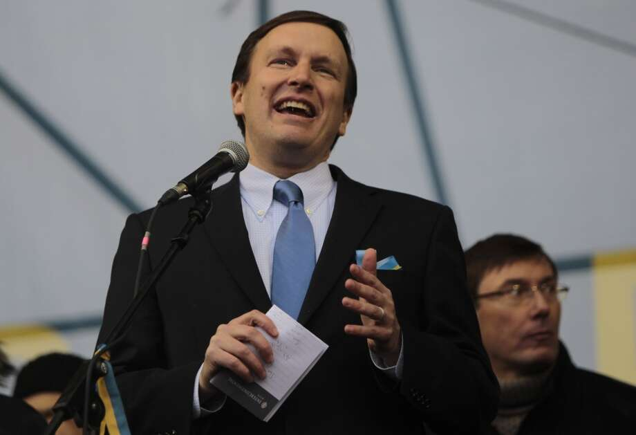 "Sen. Chris Murphy, D-Conn., @ChrisMurphyCT - ""your ignorance is overshadowed only by your naivete. #LMAO"" Photo: Sergei Chuzavkov, Associated Press"