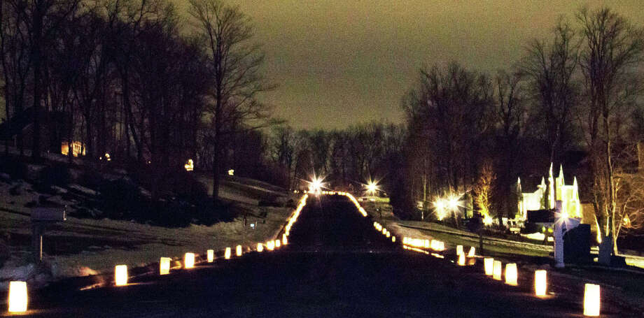 Lighting the way  Ania Debesciak of New Milford captured this image of luminaries lining Meredith Lane in New Milford as part of several neighborhoods' coordinated tribute to the community effort to provide help for those in need of a warm home this winter. December 2013  Courtesy of Ania Debesciak Photo: Contributed Photo / The News-Times Contributed