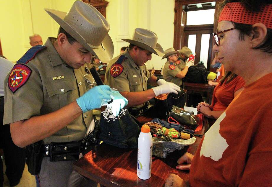 DPS troopers check bags before admitting people into the Senate chamber as the Senate debates passage of abortion legislation on July 12, 2013. Photo: TOM REEL