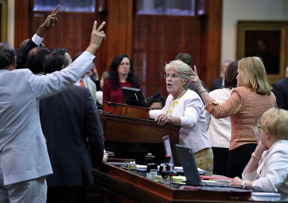 Democrat senators crowd the podium trying to stall a vote in the late minutes after Fort Worth Senator Wendy Davis filibusters in an effort to cause abortion legislation to die without a vote on the floor of the Senate Tuesday, June 25, 2013. Photo: TOM REEL