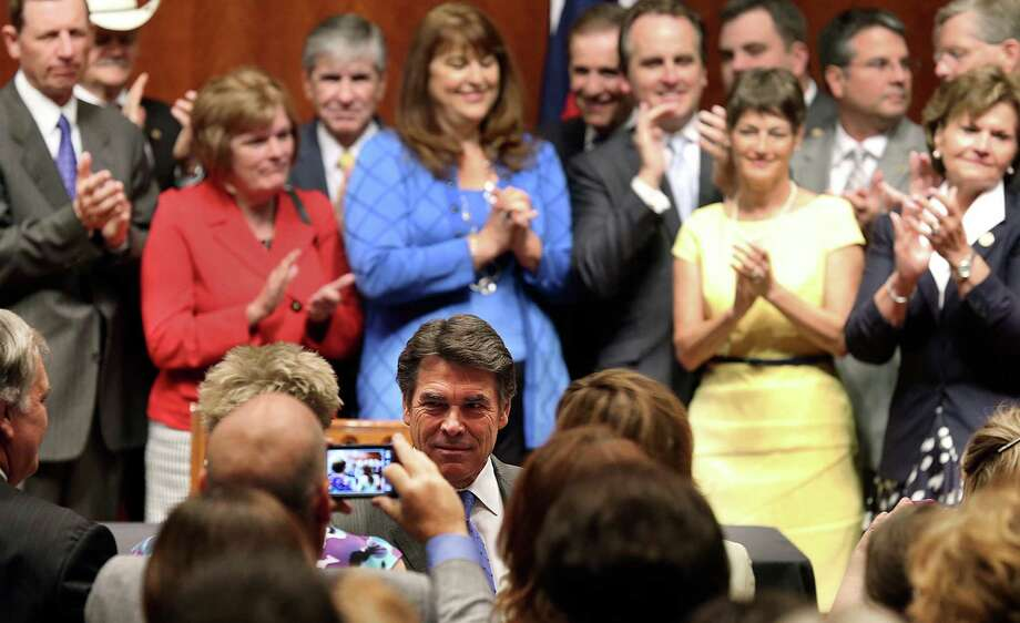 Gov. Rick Perry responds to applause before he signs into law the abortions restrictions bill  on July 18, 2013. Photo: TOM REEL
