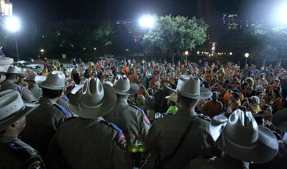 DPS troopers keep protestors from re-entering the Capitol building after the Senate debates passes abortion legislation on July 12, 2013. The abortion debate would rage on after the passage of the bill. Several clinics closed in West Texas and the Valley in South Texas. Wendy Davis launched her gubernatorial candidacy against Republican Greg Abbott months after the contentious vote. Photo: TOM REEL