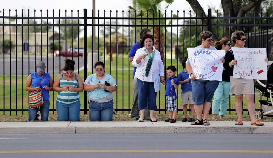 Pro-life supporters gather across the street from a Stand With Texas Women rally held Friday July 12, 2013 at Planned Parenthood in McAllen, Tx. Photo: Edward A. Ornelas, San Antonio Express-News / © 2013 San Antonio Express-News