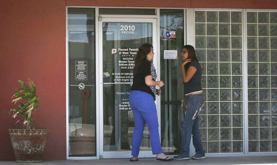 Clients of Planned Parenthood find the office in San Angelo, TX closed, on Wednesday, Sept. 4, 2013. Two women arrived at the office for undetermined services did not know if the closure. Photo: Bob Owen, San Antonio Express-News / © 2012 San Antonio Express-News