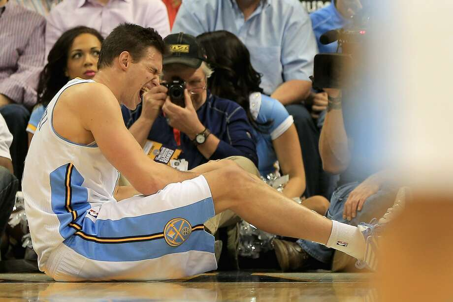 Danilo Gallinari #8 of the Denver Nuggets grimaces as he injures his left knee and was forced to leave the game against the Dallas Mavericks at the Pepsi Center on April 4, 2013 in Denver, Colorado. The Nuggets defeated the Mavericks 95-94. NOTE TO USER: User expressly acknowledges and agrees that, by downloading and or using this photograph, User is consenting to the terms and conditions of the Getty Images License Agreement.  (Photo by Doug Pensinger/Getty Images) Photo: Doug Pensinger, Getty Images