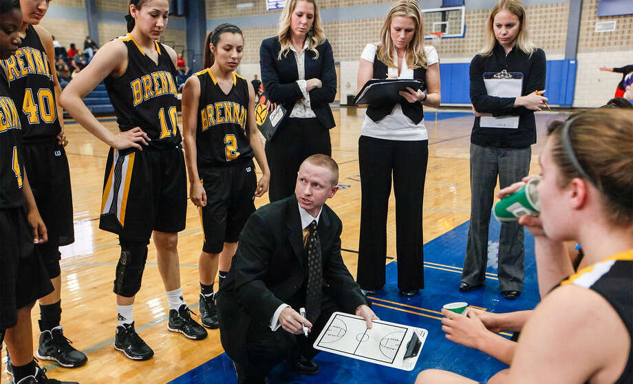 Brennan girls basketball coach Koty Cowgill, center, talks to the team during a timeout in their Jan. 4 game with Brackenridge at the Lanier Alumi Center. Brennan won the game 79-37. Photo: Marvin Pfeiffer / Northwest Weekly / Prime Time Newspapers 2013