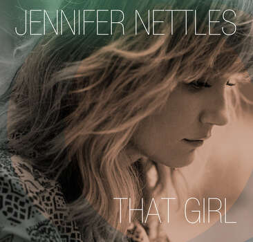 "This CD cover image released by Universal Nashville shows ""That Girl,"" by Jennifer Nettles. Nettles made her career singing with others as a part of the Grammy-winning band Sugarland and performing well-known duets with artists like Bon Jovi, James Taylor and many more. But now she'†s striking out on her own with her first solo album.Universal Nashville Keep clicking for photos of how Houston celebrates the Fourth of July.  Photo: Associated Press / Universal Nashville"