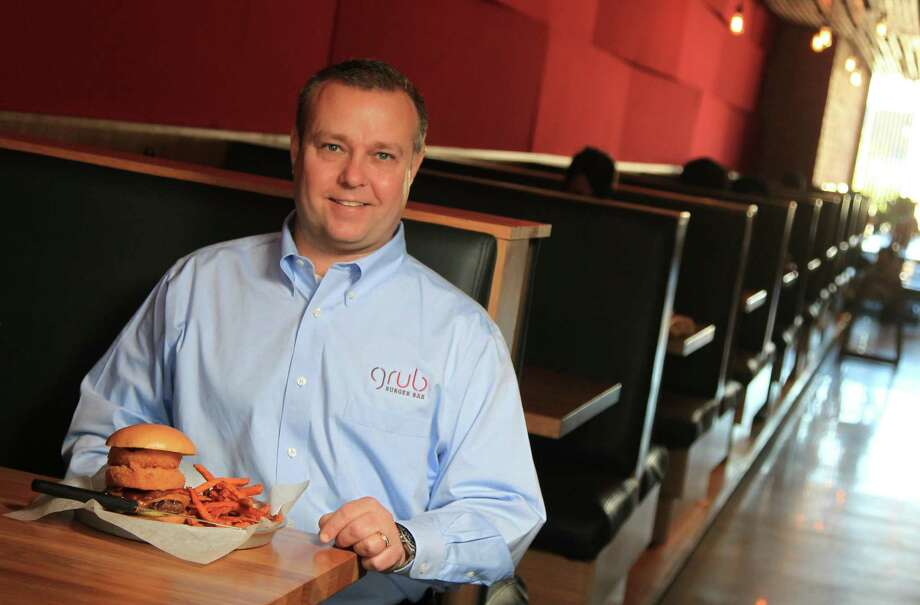 Walter Cervin, a partner at Grub Burger Bar, is a Sysco Food customer who sees possible benefits from the merger. Photo: Mayra Beltran, Staff / © 2013 Houston Chronicle