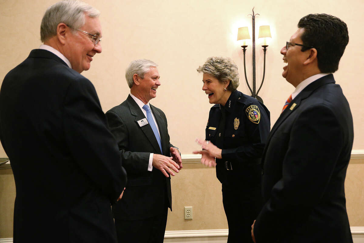 """Bexar County Sheriff Susan Pamerleau, second from left, shares a laugh with from left, San Antonio Chamber of Commerce Executive Vice-President Bill Mock, Board of Directors Chair David McGee and President CEO Richard Perez before she gave the first """"State of the Sheriff"""" address at the monthly chamber's luncheon at the Westin Riverwalk, Tuesday, Jan. 14, 2014."""