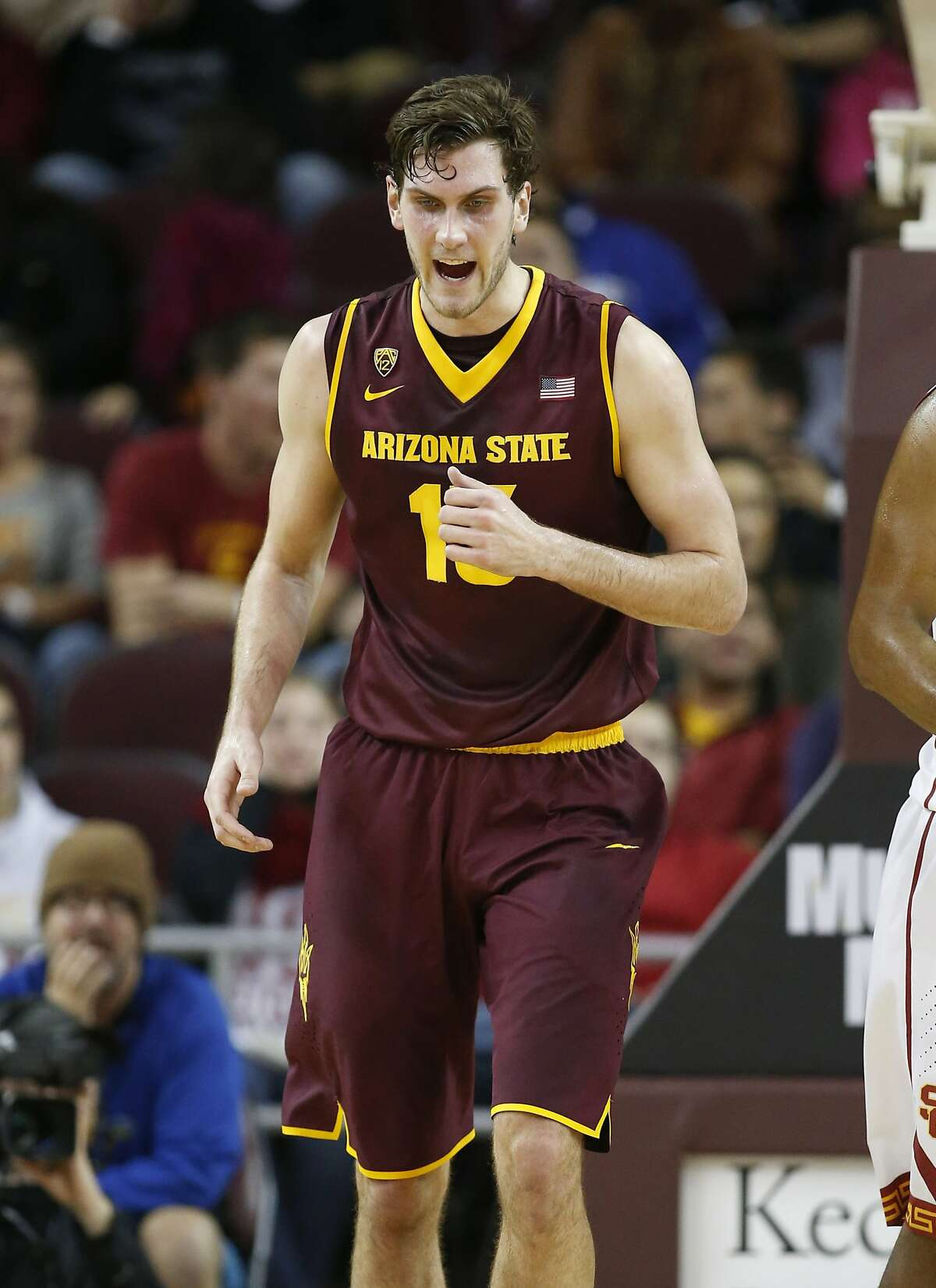Arizona State's Jordan Bachynski, right, dunks the ball over Southern California's Omar Oraby, left, of Egypt during the second half of an NCAA college basketball game, Thursday, Jan. 9, 2014, in Los Angeles. Arizona State won 79-60. (AP Photo/Danny Moloshok)