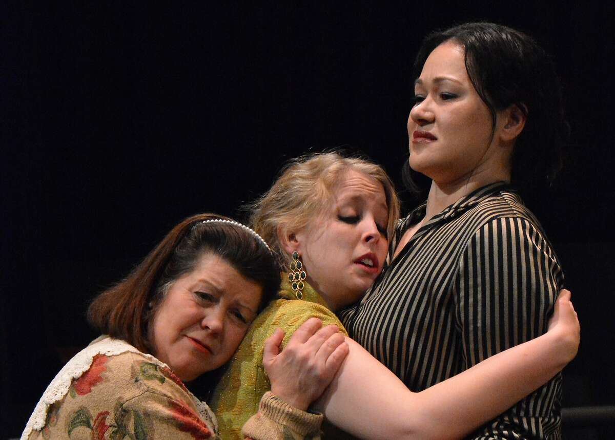 """Kalina (Eden Neuendorf, center) makes a desperate bid to be part of the family of Kelly (Karen Offereins, right) and her mother-in-law Carol (Jean Forsman) in Custom Made Theatre's """"The Pain and the Itch"""""""