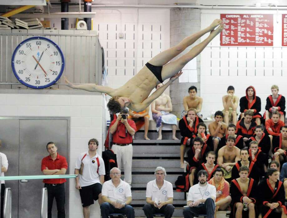 Greenwich High School diver Riccardo Marcangeli in action during the boys high school swim meet between Greenwich High School and Fairfield Prep at Greenwich, Saturday, Jan. 11, 2014. Photo: Bob Luckey / Greenwich Time