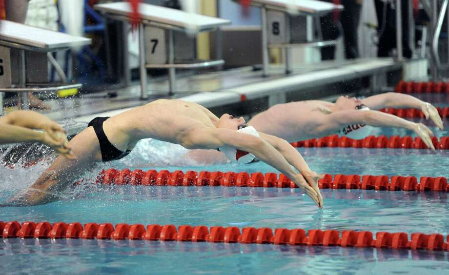 At center, Jack Montesi of Greenwich at the start of the 200 Medley Relay event during the boys high school swim meet between Greenwich High School and Fairfield Prep at Greenwich, Saturday, Jan. 11, 2014. Photo: Bob Luckey / Greenwich Time