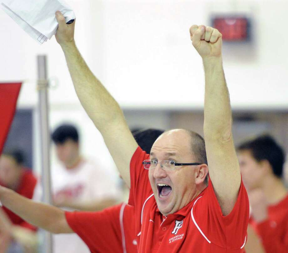 Fairfield Prep swim coach Rick Hutchinson reacts during the boys high school swim meet between Greenwich High School and Fairfield Prep at Greenwich, Saturday, Jan. 11, 2014. Photo: Bob Luckey / Greenwich Time