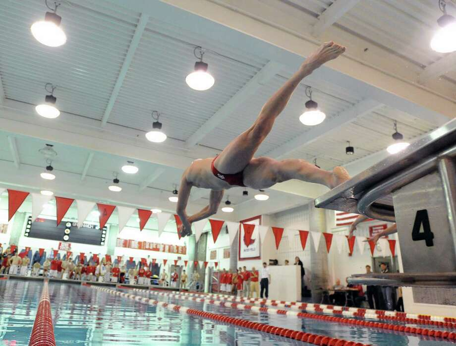 Bjorn Davis of Fairfield Prep launches off the block at the start of the 50 Freestyle event that he finished second in during the boys high school swim meet between Greenwich High School and Fairfield Prep at Greenwich, Saturday, Jan. 11, 2014. Photo: Bob Luckey / Greenwich Time