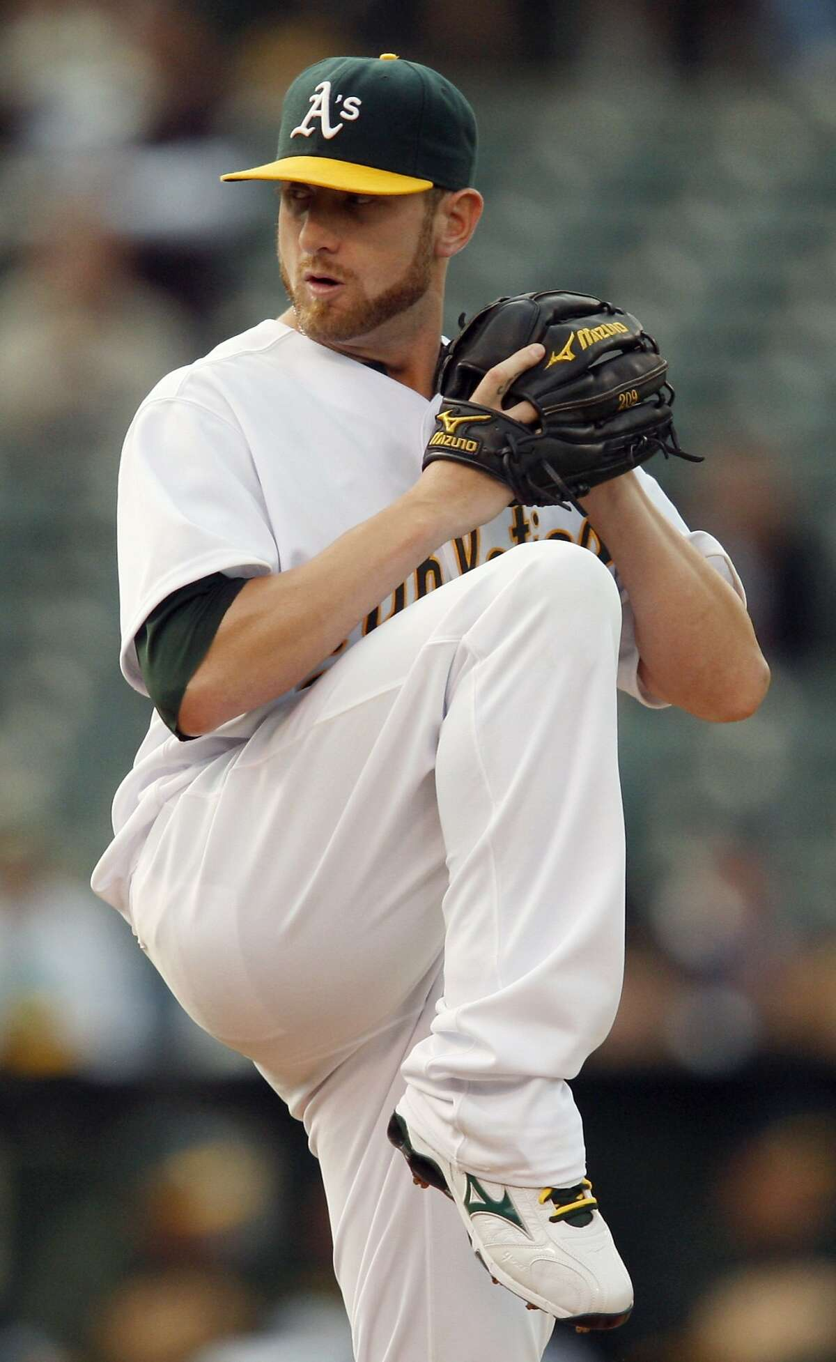 Oakland Athletics pitcher Dallas Braden works against the Cincinnati Reds during the first inning of a baseball game Tuesday, June 22, 2010, in Oakland, Calif.
