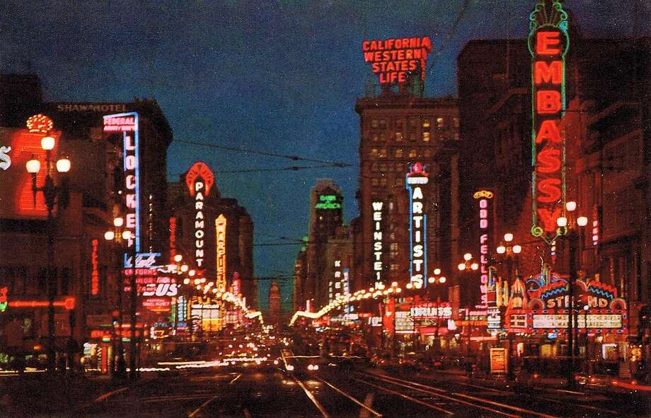 This 50-year-old card depicts the then lively section of Market Street that is today known as seedy mid-Market. To see it so alive and so colorful, full of flashing neon, makes one pine for the days when movie palaces really were like this and seeing a movie in one of them was an event. From the collection of Glenn Koch.