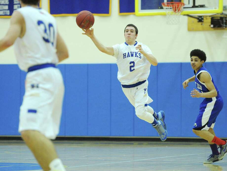 Newtown's Troy Frangione (2) makes a one-handed pass downcourt in Newtown's 74-54 win over Abbott Tech in the high school boys basketball at Newtown High School in Newtown, Conn. on Friday, Jan. 10, 2014. Photo: Tyler Sizemore / The News-Times