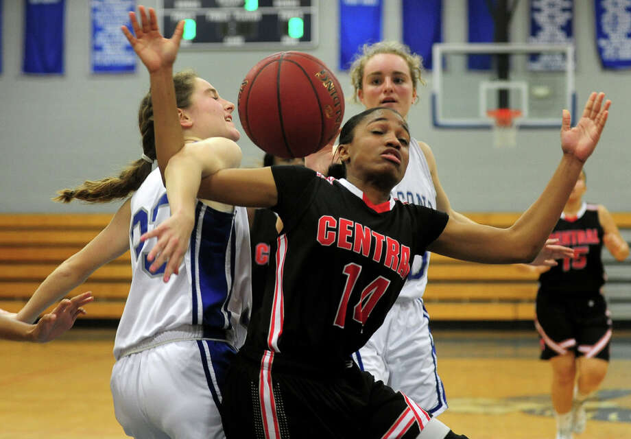 Fairfield Ludlowe's Charlotte Blatt, left, fouls Central's Demere Hunt-Stephens as she attemots a shot, during girls basketball action in Fairfield, Conn. on Tuesday January 14, 2014. Photo: Christian Abraham / Connecticut Post