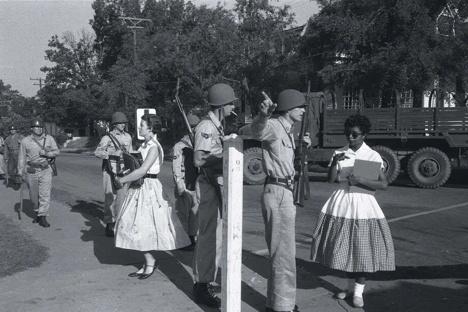 In this photo from Sept. 4, 1957, Arkansas National Guardsmen turn away Elizabeth Eckford, right, as she approaches Little Rock Central High. Their actions, on orders from Gov. Orval Faubus, made the city a symbol of school segregation. Photo: Will Counts, MBR / The Arkansas Democrat-Gazette