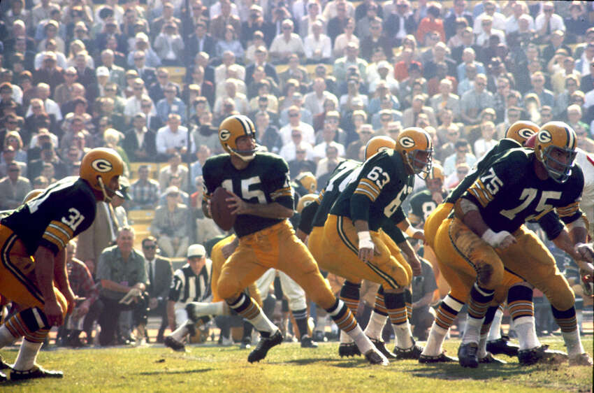 Green Bay quarterback Bart Starr (15) drops back to pass during Super Bowl I, a 35-10 victory over the Kansas City Chiefs on Jan. 15, 1967, at the Los Angeles Memorial Coliseum in Los Angeles.