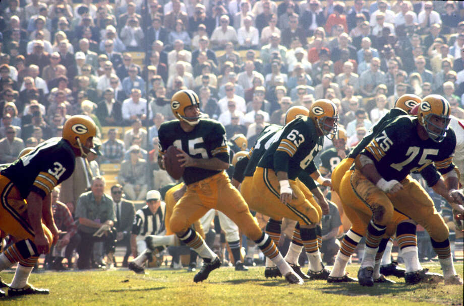 Green Bay quarterback Bart Starr (15) drops back to pass during Super Bowl I, a 35-10 victory over the Kansas City Chiefs on Jan. 15, 1967, at the Los Angeles Memorial Coliseum in Los Angeles. Photo: James Flores, Getty Images / Getty Images North America